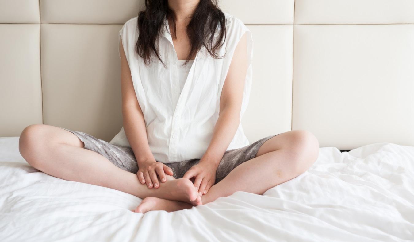 Femme dans son lit